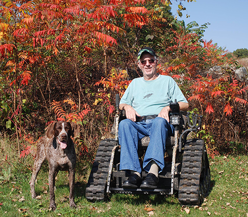 Ray Hitchcock with his dog and amazing Tracker wheelchair.