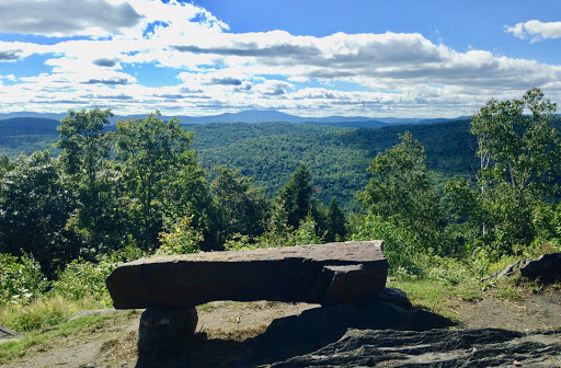 Stone bench by mountain view