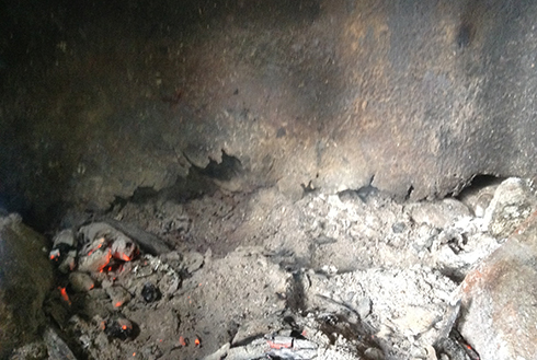 New welded steel plates in the fireplace insert will repair holes, contain the fire, and prevent a potential hazard.