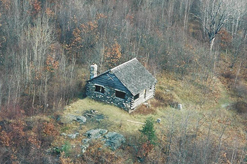 This aerial view of the original cabin shows the south and west sides after the Littmans' 1997 gift to WHPA, but before the first renovation.  Note the surrounding trees that grew up in the 33 years since the cabin was built.